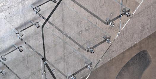 Detalle escalera voladiza con peldaños y barandilla de cristal