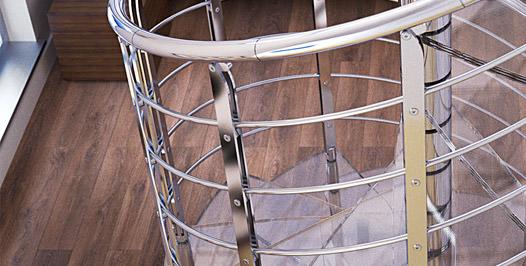 Detalle de escalera de caracol con peldaños de vidrio